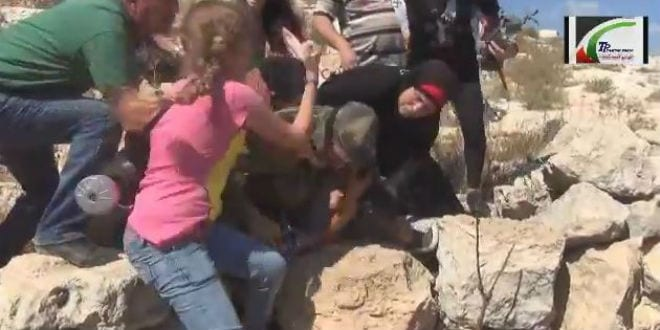 A mob of Palestinian women are seen attacking an IDF soldier who was attempting to arrest a Palestinian youth for violent activity directed towards the army. (Photo: Video Screenshot)