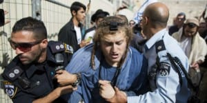 Israeli police arrest an Israeli who tried to enter the Temple Mount in Jerusalem's Old City on October 30, 2014, wearing his tefillin. (Photo: Yonatan Sindel/Flash90)