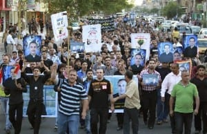 Mourners march during a funeral for victims of an attack on the Our Lady of Salvation church in Baghdad, November 2, 2010. (Photo: Thaier Al-Sudani/MEMRI)