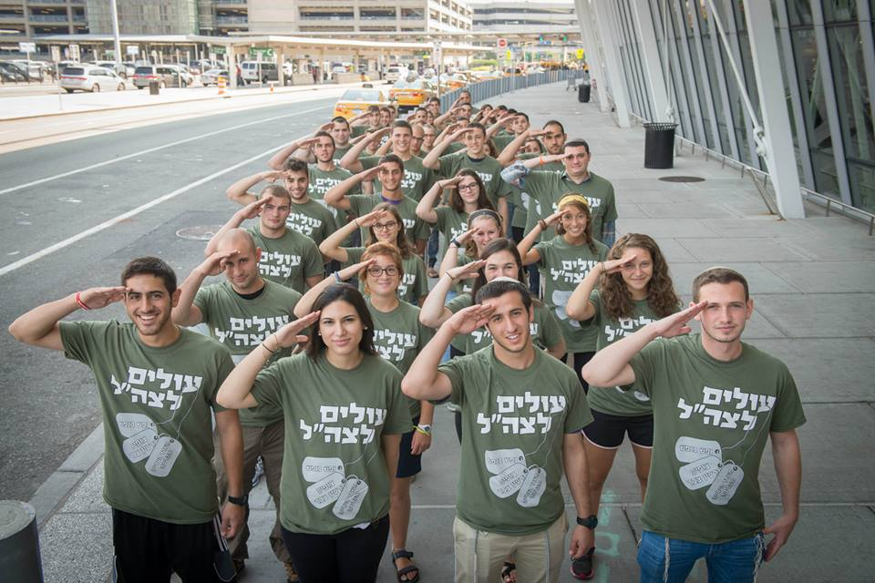 Future Israeli soldiers at JFK moments before they boarded the plane to Israel. The lone soldiers made aliyah on Tuesday, August 18, 2015. (Photo: Shahar Azran)