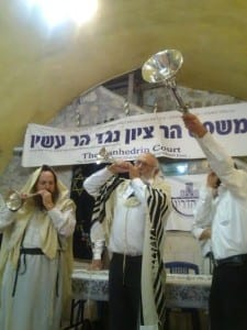 Members of the Sanhedrin blow silver horns and shofars to open the trial. (Photo: Breaking Israel News)