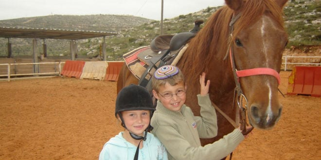 At the therapeutic horse farm at Gush Shiloh, victims of terror benefit from unconventional therapies. (Photo: Courtesy)