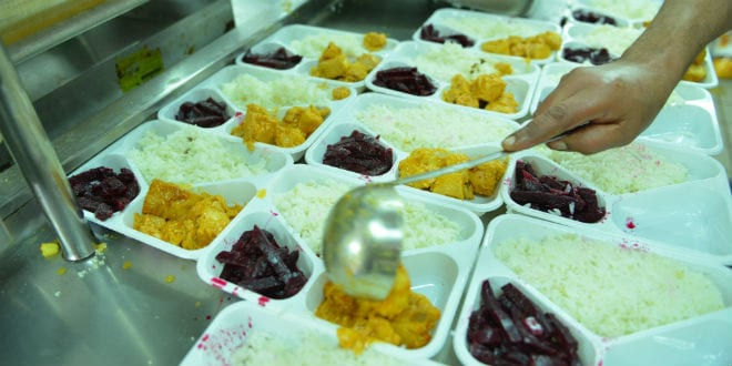 Preparing meals to be given to needy families. (Photo courtesy of Colel Chabad)
