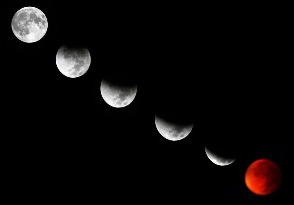A combination of pictures showing the different stages of the Blood Moon lunar eclipse with the perigee full moon as seen from Israel, September 28, 2015. (Photo: Abed Rahim Khatib/Flash90)