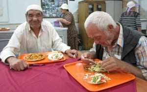 Avraham Abu, left, has come to Meir Panim for meals twice a week for seven years.