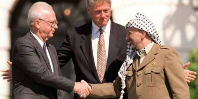 Israeli Prime Minister Yitzhak Rabin with President Clinton and Yasser Arafat during the signing of the Oslo I Accord in 1993. (Photo: IDF Spokesperson's Unit)