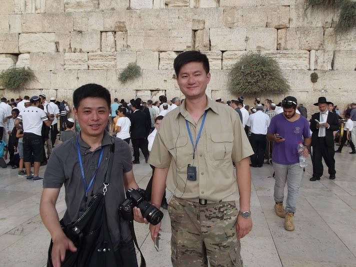 Asian tourists gather at the Western Wall to take part in the Biblical commandment of Hakhel. (Photo: Adam Eliyahu Berkowitz/ Breaking Israel News)