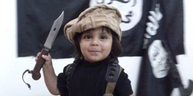 ISIS toddler beheading his teddy bear. (Photo: YouTube screenshot)