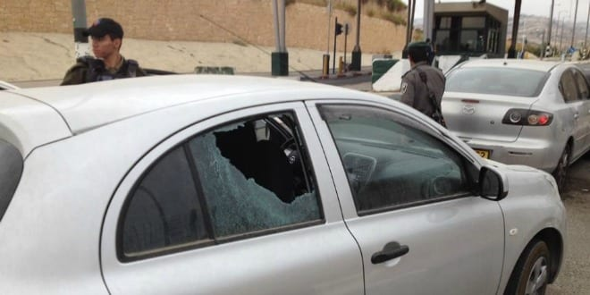 Car damaged from rock attack by terrorists. (Photo: TPS)