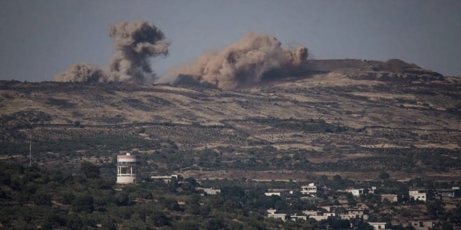 Syrians bombing each other as viewed from Israel's Golan Heights. (Photo: Basel Awidat / Flash90)
