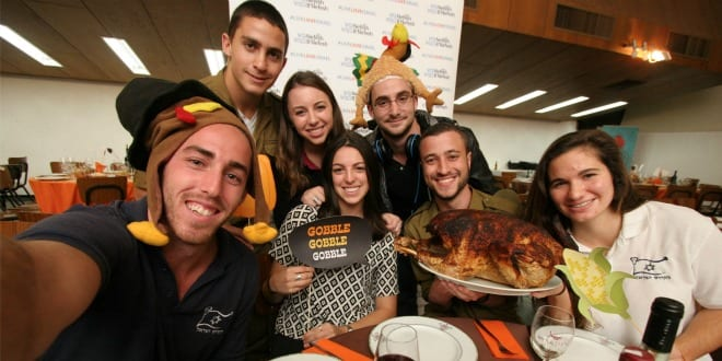Lone Soldiers and new Olim at last year's Nefesh B'Nefesh Thanksgiving celebration. (Photo: Yonit Schiller)