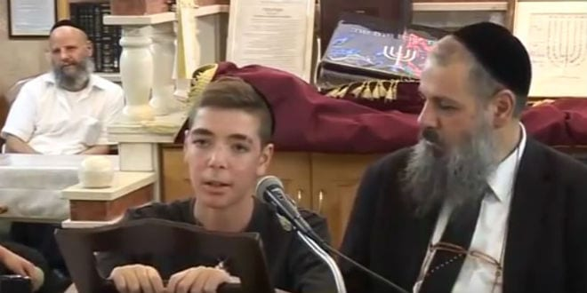 15-year-old Israeli youth Natan recounting his near death experience with Rabbi Rami Levy (right) in this video screenshot.