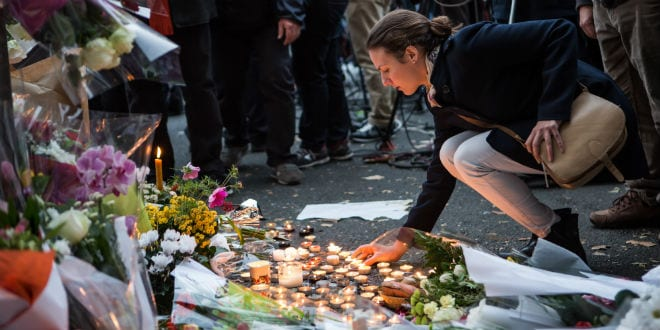 People place flowers and light candles in tribute for the victims of the Paris terror attacks close to the Bataclan theatre in the 11th district of Paris, France on November 14, 2015. (Photo: Laurence Geai/Flash90)