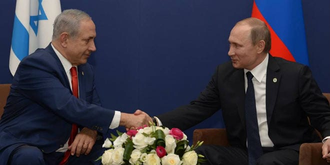 Prime Minister Benjamin Netanyahu shakes hands with Russian President Vladimir Putin at a climate conference in Paris, November 30, 2015. (Photo: Amos Ben Gershom/GPO)