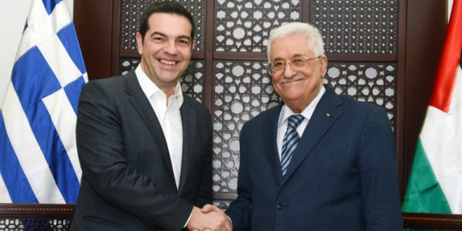 Greece Prime Minister Alexis Tsipras (L) shake hands with Palestinian President Mahmud Abbas as he arrives for a meeting in the West Bank city of Ramallah on November 26, 2015, during an official visit. (Photo: Flash90)