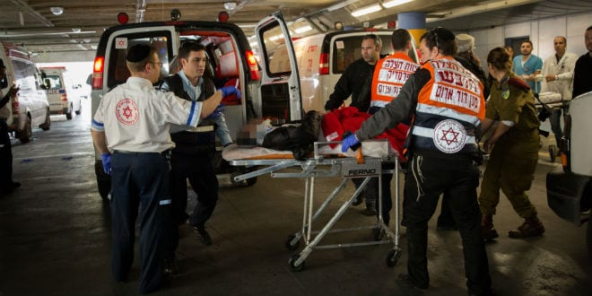Wounded terror victims are evacuated for emergency treatment at Shaarei Tzedek hospital in Jerusalem, after they were wounded when a Palestinian driver rammed his car into a bus stop injuring about 13 people who were waiting there, on Herzl Boulevard at the entrance to the city, on December 14, 2015. (Photo: Hadas Parush/Flash90)