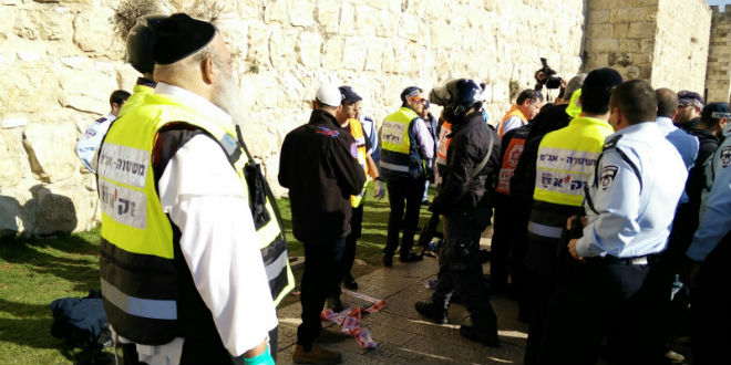 ZAKA volunteers at the scene of the terror attack near the Jaffa Gate on December 23, 2015. (Photo: Courtesy of ZAKA)