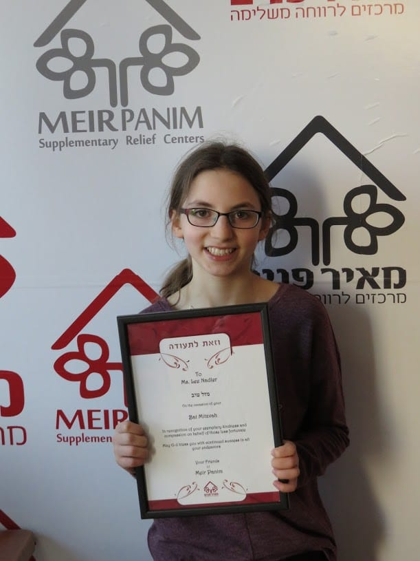 Lee Nadler holds a certificate presented to her by Meir Panim. (Photo: Nadler family)