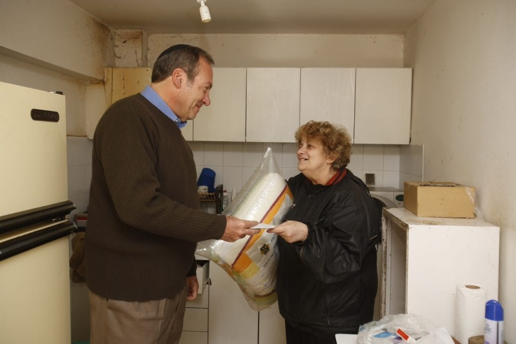 In Israel, Rabbi Yechiel Eckstein (left) meets with Olga, an immigrant from the former Soviet Union and a recipient of aid from a food program of the Eckstein-led International Fellowship of Christians and Jews. (Photo: Courtesy International Fellowship of Christians and Jews)