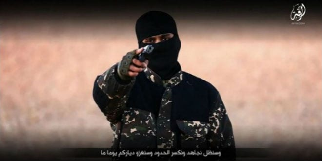 Screenshot from a video posted online by  the Communications Arm of Islamic State shows an ISIS militant threatening Britain. (Militant Video via AP)
