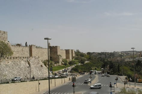 "Old City Walls built by the Ottomans. The road pictured marks part of the 1949 ""green line"" that divided East and West Jerusalem until 1967. (Photo: Sherwood Burton)."