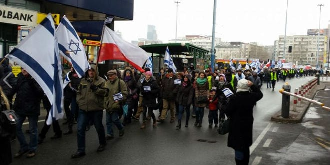 Hundreds of Polish Christians and Jews march in solidarity with Israel in Warsaw. (Photo: Edward Ćwierz/ Facebook)