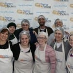 Breaking Israel News Staff Packs in the Fun for Charity at Pantry Packers