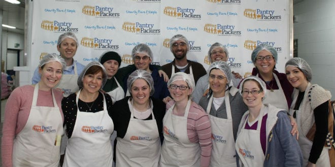 The Breaking Israel News staff at Colel Chabad's Pantry Packers in Jerusalem (Photo: Breaking Israel News)