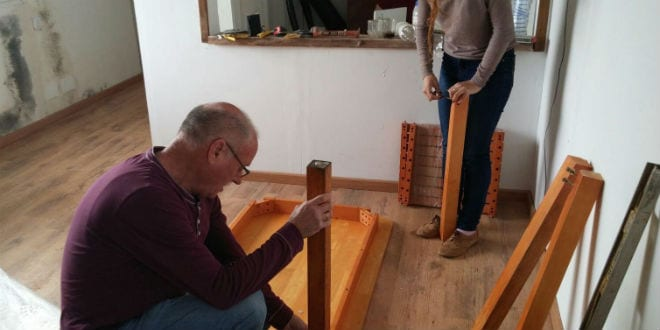 Karmey Chesed volunteers build a table for an IDF soldier. (Photo: Karmey Chesed)