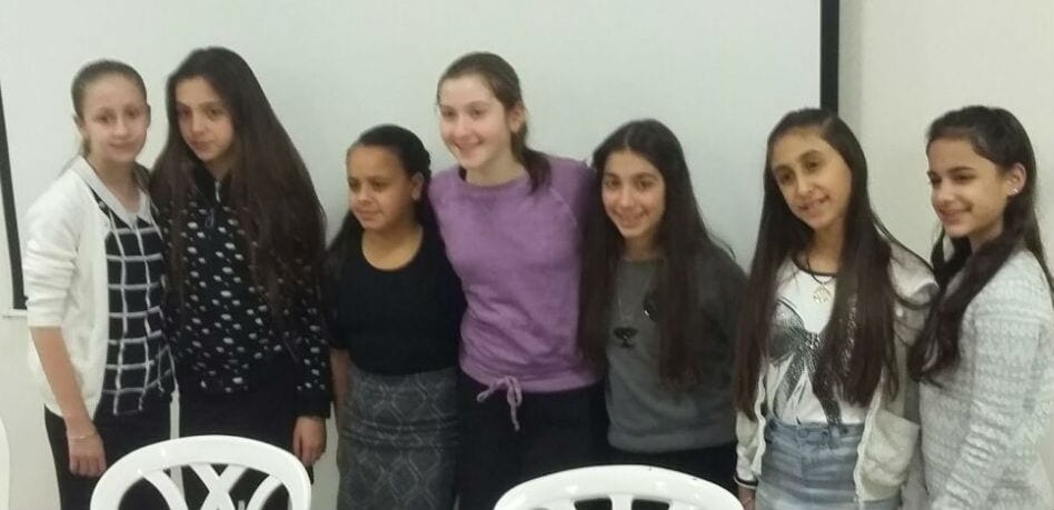 Kayla Muchnick (pictured in the purple shirt) stands with fellow bat mitzvah girls from Beit Elazraki (Photo: Paint Party Events)