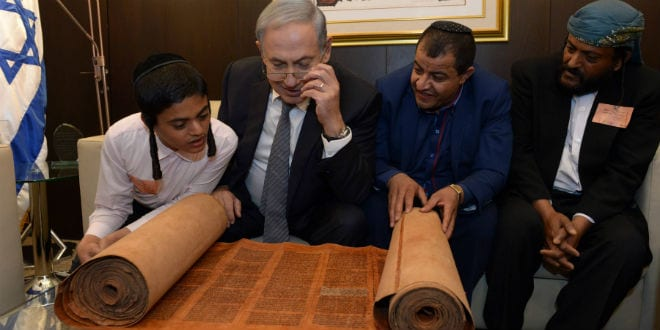 Israeli Prime Minister Benjamin Netanyahu looks at an 800 hundred years old Torah scroll as he meets with Yemenite Jews who were brought to Israel last week as part of a secret rescue operation, at the Knesset, the Israeli parliament in Jerusalem. (Photo: Haim Zach/GPO)