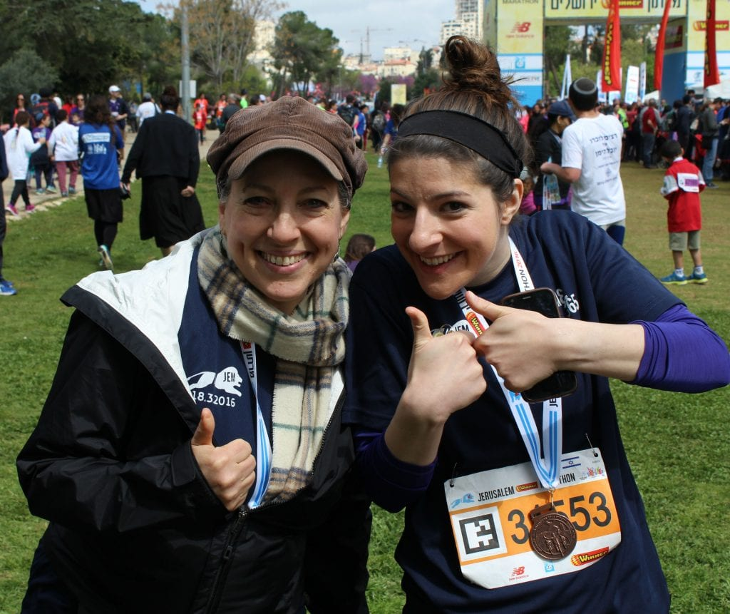 Tsiva Fox (L), Director of Client Relations at Breaking Israel News and Gila Leipnik (R), Social Media Manager at Israel365 are all smiles after running in the Jerusalem Marathon on March 18, 2016 (Photo: Breaking Israel News)