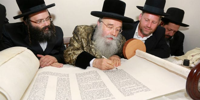 Rabbi Yosef Berger looks on as his Torah for the Messiah is completed. (Photo: David's Tomb/Rabbi Yosef Berger)