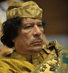 Former Libyan dictator Muammar al-Gaddafi. (Photo: U.S. Navy photo by Mass Communication Specialist 2nd Class Jesse B. Awalt via Wikimedia Commons)