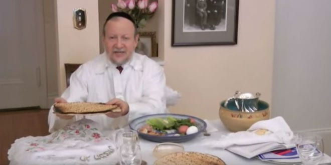 Making the blessing over the matzah prior to eating it at the seder. (Photo: Jewish Treats / YouTube)