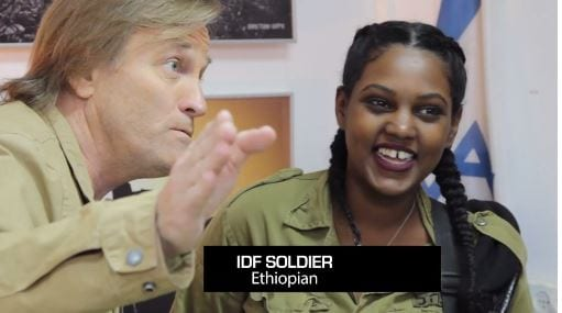 """Brad Stine interviews an Ethiopian IDF soldier in the documentary """"Hating Israel: In Search of the Truth Behind BDS. (Photo: Video Screenshot/PJTN)"""