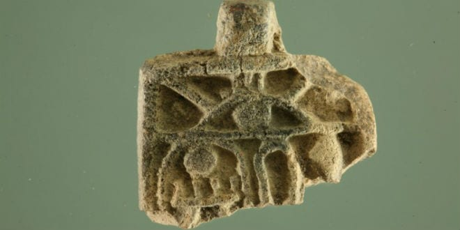 The 3,200 year old Egyptian amulet measures The small amulet is in the shape of a pendant, missing its bottom part, measures 21mm wide, 4 mm thick and its preserved length is 16 mm.  A loop on top allowed it to be strung and hung on the neck. (Photo: City of David / Temple Mount Sifting Project / Israel Antiquities Authority)