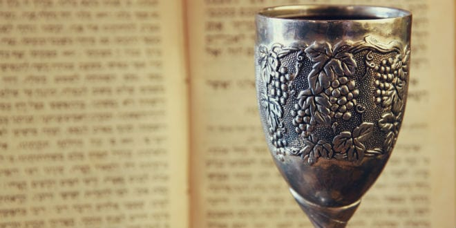 A decorated cup for Kiddush, sanctifying the wine. (Photo: tomertu/ Shutterstock)