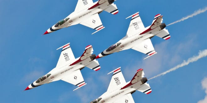 US Air Force USAF Thunderbirds F-16 showing precision of formation flying during the airshow on May 8, 2012. (Chris Parypa Photography / Shutterstock.com)