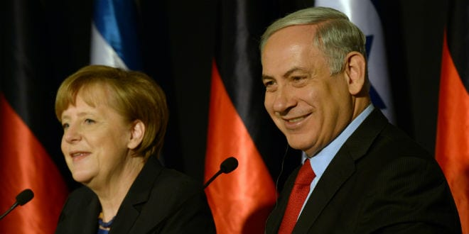 Israeli Prime Minister Benjamin Netanyahu holds a joint press conference with German Chancellor Angela Merkel at the King David hotel in Jerusalem on February 25, 2014. (Haim Zach/GPO/FLASH90)