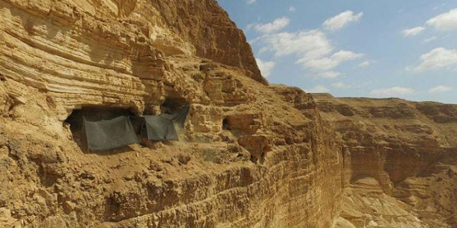 The cave where the archaeological excavation is being conducted is situated c. 80 meters from the top of the cliff and c. 250 meters above the base of the canyon. (Photo: Guy Fitoussi, courtesy of the IAA Unit for the Prevention of Antiquities Robbery)