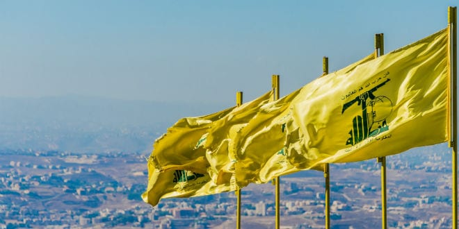 Hezbollah flags fly in southern Lebanon. (Photo: John Grummitt / Shutterstock.com)