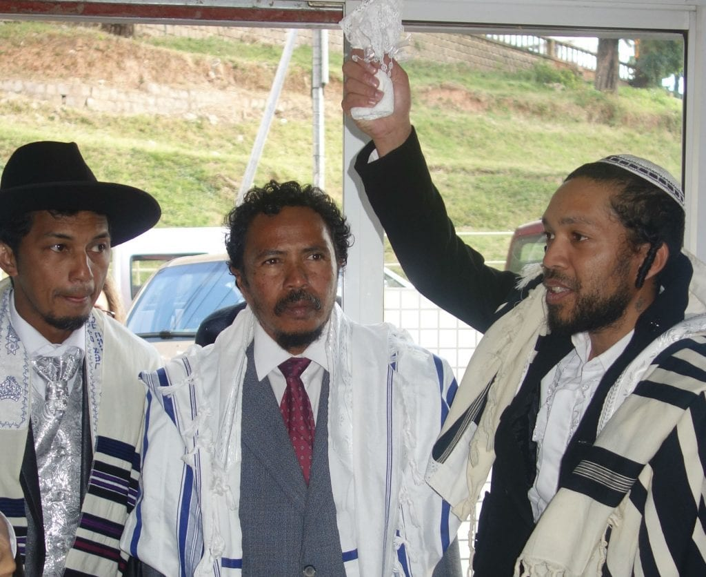 Malagasy Jewish men take part in the laws required upon marriage. (Photo: Barbara Vinick/Kulanu)