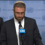 Natan Meir, husband of Dafna Meir who was killed by a terrorist in January, speaks at the UN in April. (Photo: Video Screenshot/Arutz7)
