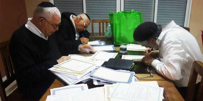 Rabbis pore over conversion and marriage documents (Ketubot) for Malagasy Jews. (Photo: Barbara Vinick/Kulanu)