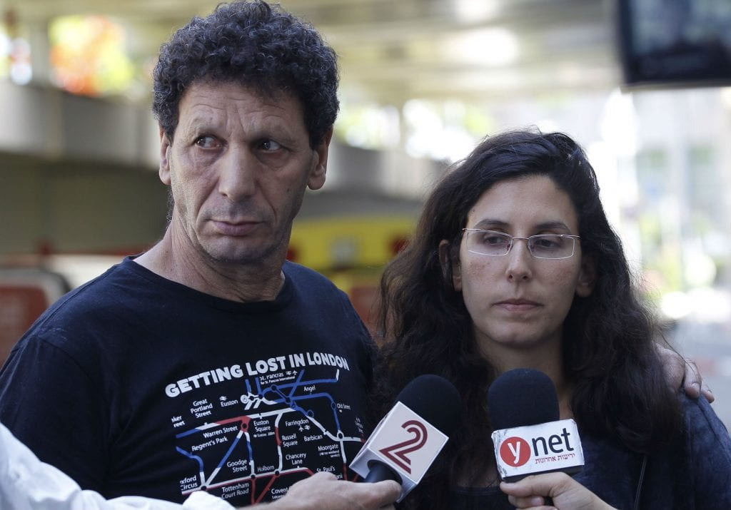 Avner Bar, father of Asaf Bar who was wounded in yesterday's shooting attack, together with Asaf's sister, Dana Cohen, speak with the press at Ichilov Hospital where Asaf is hospitalized, on June 9, 2016. A suspect shot and wounded 9 people, 4 of them have died of their wounds, at the Sarona Market shopping center in tel Aviv, on June 8. (Photo: Miriam Alster/Flash90)