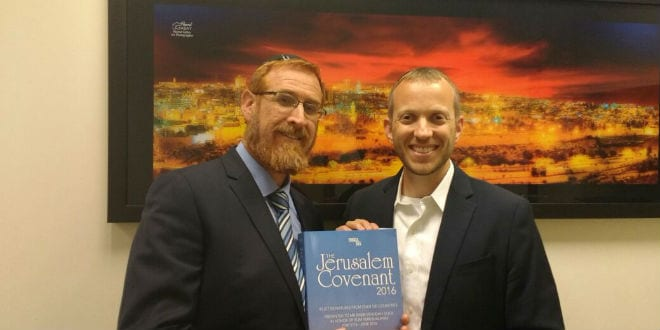 Rabbi Tuly Weisz of Israel365 (right) presents MK Yehudah Glick (Likud) with the Jerusalem Covenant. (Courtesy Tuly Weisz)