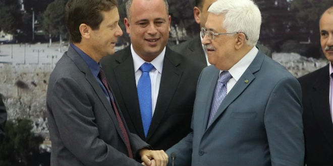 Isaac Herzog (L) and Hilik Bar (C) seen with Palestinian Authority President Mahmoud Abbas during a meeting between Palestinian politicians and Israeli parliament members in the West Bank city of Ramallah on October 07, 2013. (Photo: FLASH90)