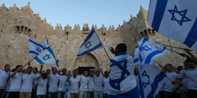 Thousands of young Jewish boys wave Israeli flags as they celebrate Jerusalem Day, dancing and marching their way through Damascus Gate to the Western Wall, on May 17, 2015. Jerusalem Day celebrates the anniversary of its capture of Arab East Jerusalem in the Six Day War of 1967. (Yonatan Sindel/Flash90)