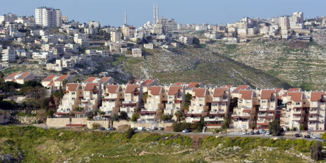The Israeli city of Maale Adumim against the Arab village of Al-Eizariya. Ma'ale Adumim, which is located near Jerusalem, boasts a population of at least 40,000 residents. (Photo: ChameleonsEye / Shutterstock.com)